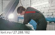 Купить «The mechanic works under the hood of the car», видеоролик № 27288182, снято 18 августа 2019 г. (c) Константин Шишкин / Фотобанк Лори