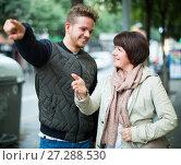 Купить «Female tourist asks for directions», фото № 27288530, снято 25 октября 2016 г. (c) Яков Филимонов / Фотобанк Лори