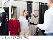 Купить «Family choosing dress and blouse at clothing shop», фото № 27288762, снято 24 октября 2016 г. (c) Яков Филимонов / Фотобанк Лори