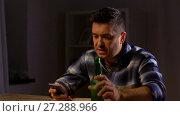 Купить «man with smartphone drinking bottled beer at home», видеоролик № 27288966, снято 10 декабря 2017 г. (c) Syda Productions / Фотобанк Лори
