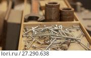 Купить «wood screws and tools in box at workshop», видеоролик № 27290638, снято 17 ноября 2017 г. (c) Syda Productions / Фотобанк Лори