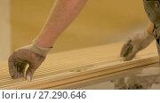 Купить «worker hands placing fibreboard planks at workshop», видеоролик № 27290646, снято 17 ноября 2017 г. (c) Syda Productions / Фотобанк Лори
