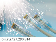 Купить «Closeup of RJ45 UTP LAN on the background of optical fibers with blurred lights», фото № 27290814, снято 19 декабря 2018 г. (c) Mikhail Starodubov / Фотобанк Лори