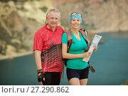 Купить «Portrait male  and women  a mountain bike», фото № 27290862, снято 4 августа 2015 г. (c) Наталья Давыдова / Фотобанк Лори
