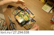 Купить «Ufa, Russian Federation - November 24, 2017 Child unpacks and builds Lego NEXO KNIGHTS  Combo NEXO power», видеоролик № 27294038, снято 24 ноября 2017 г. (c) Mikhail Erguine / Фотобанк Лори