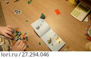 Купить «Ufa, Russian Federation - November 24, 2017 Child unpacks and builds Lego NEXO KNIGHTS  Combo NEXO power», видеоролик № 27294046, снято 24 ноября 2017 г. (c) Mikhail Erguine / Фотобанк Лори