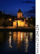 Купить «Месяц в ночном небе. Ночной Тбилиси, вид на кафедральный собор Сиони и отражение огней в реке. Грузия», фото № 27294234, снято 23 сентября 2017 г. (c) Яна Королёва / Фотобанк Лори