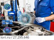 Купить «mechanic man with wrench repairing car at workshop», фото № 27295646, снято 1 июля 2016 г. (c) Syda Productions / Фотобанк Лори