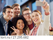 Купить «business team with conference badges taking selfie», фото № 27295682, снято 13 мая 2017 г. (c) Syda Productions / Фотобанк Лори