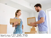 Купить «happy couple with boxes moving to new home», фото № 27295710, снято 4 июня 2017 г. (c) Syda Productions / Фотобанк Лори