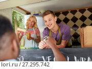 Купить «salesman taking customer credit card at food truck», фото № 27295742, снято 1 августа 2017 г. (c) Syda Productions / Фотобанк Лори