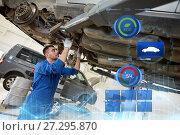 Купить «mechanic man or smith repairing car at workshop», фото № 27295870, снято 25 июня 2018 г. (c) Syda Productions / Фотобанк Лори