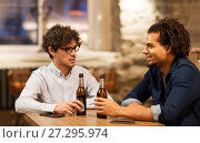 Купить «happy male friends drinking beer at bar or pub», фото № 27295974, снято 19 ноября 2016 г. (c) Syda Productions / Фотобанк Лори