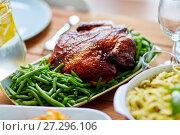 Купить «roast chicken with garnish of green peas on table», фото № 27296106, снято 5 октября 2017 г. (c) Syda Productions / Фотобанк Лори
