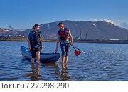 Купить «Norilsk, Russia - June 20, 2017: a guy and a girl floating on a kayak», фото № 27298290, снято 20 июня 2017 г. (c) Александр Сергеевич / Фотобанк Лори