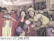 Купить «Young couple demonstrating tourist equipment», фото № 27298870, снято 8 марта 2017 г. (c) Яков Филимонов / Фотобанк Лори