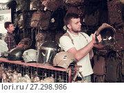 Купить «Men choosing helmet», фото № 27298986, снято 4 июля 2017 г. (c) Яков Филимонов / Фотобанк Лори