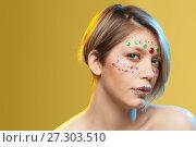 Купить «young woman with holiday makeup on her face», фото № 27303510, снято 12 декабря 2017 г. (c) Владимир Мельников / Фотобанк Лори