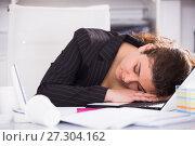 Купить «Woman worker is sleeping after productive day at work», фото № 27304162, снято 21 мая 2017 г. (c) Яков Филимонов / Фотобанк Лори