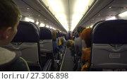 Купить «Moscow, Russian Federation – March 19, 2017: Interior of airplane with passengers on seats.», видеоролик № 27306898, снято 19 марта 2017 г. (c) Курганов Александр / Фотобанк Лори