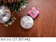 Silver coin three rubles - St. George Shoots the Dragon. Toys and decorative box on the Christmas tree. Стоковое фото, фотограф Евгений Ткачёв / Фотобанк Лори
