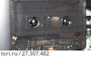 Купить «vintage orange audio cassette tape with a blank label», видеоролик № 27307482, снято 12 апреля 2017 г. (c) Курганов Александр / Фотобанк Лори