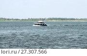 Купить «Motor yacht at the river», видеоролик № 27307566, снято 25 марта 2014 г. (c) Курганов Александр / Фотобанк Лори