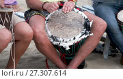 Купить «Unidentified man playing on drum», видеоролик № 27307614, снято 18 апреля 2017 г. (c) Курганов Александр / Фотобанк Лори