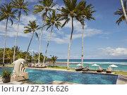 Купить «Swimming pool of Candi Beach Resort and Spa with a view towards Sengkidu Beach. Candidasa, Manggis subdistrict, Karangasem regency, Bali, Indonesia.», фото № 27316626, снято 27 мая 2020 г. (c) age Fotostock / Фотобанк Лори