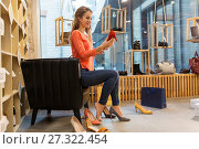 Купить «young woman trying high heeled shoes at store», фото № 27322454, снято 22 сентября 2017 г. (c) Syda Productions / Фотобанк Лори