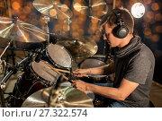 Купить «musician playing drum kit at concert over lights», фото № 27322574, снято 18 августа 2016 г. (c) Syda Productions / Фотобанк Лори
