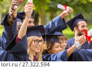 Купить «happy students in mortar boards with diplomas», фото № 27322594, снято 24 сентября 2016 г. (c) Syda Productions / Фотобанк Лори