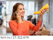 Купить «young woman calling on smartphone at shoe store», фото № 27322674, снято 22 сентября 2017 г. (c) Syda Productions / Фотобанк Лори