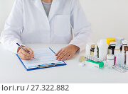 Купить «doctor with medicines and clipboard at hospital», фото № 27322882, снято 27 сентября 2017 г. (c) Syda Productions / Фотобанк Лори