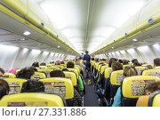 Купить «Interior of commercial airplane during flight.», фото № 27331886, снято 11 марта 2020 г. (c) Matej Kastelic / Фотобанк Лори