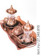 Купить «Turkish tea set. Ottoman teacup with traditional arabic ornaments on white background», фото № 27343810, снято 27 декабря 2015 г. (c) Евгений Ткачёв / Фотобанк Лори