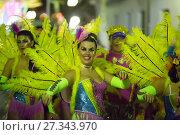 Купить «Spanish Carnaval at Sitges in evening time. Catalonia, Spain», фото № 27343970, снято 10 февраля 2016 г. (c) Яков Филимонов / Фотобанк Лори