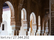 Купить «Colonnade and Arches of Courtyard of the Lions in day time. Alhambra», фото № 27344202, снято 13 мая 2016 г. (c) Яков Филимонов / Фотобанк Лори