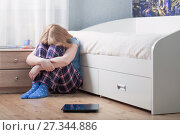 Купить «sad teenager girl with scales on floor», фото № 27344886, снято 24 декабря 2017 г. (c) Майя Крученкова / Фотобанк Лори