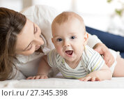 Купить «Mommy loving newborn child. Mother communicates with her baby.», фото № 27345398, снято 14 ноября 2019 г. (c) Оксана Кузьмина / Фотобанк Лори