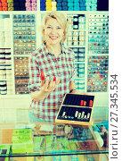 Купить «Woman seller at counter with thimbles», фото № 27345534, снято 21 марта 2019 г. (c) Яков Филимонов / Фотобанк Лори