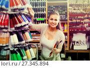 Купить «Gay woman shopping various color in tube», фото № 27345894, снято 26 июня 2019 г. (c) Яков Филимонов / Фотобанк Лори
