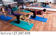Купить «Positive people practicing yoga», фото № 27347478, снято 17 июля 2018 г. (c) Яков Филимонов / Фотобанк Лори
