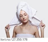 Купить «Young woman with bath towel on the head», фото № 27350178, снято 8 октября 2017 г. (c) Serg Zastavkin / Фотобанк Лори