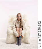Купить «Blonde woman on furry arm-chair», фото № 27350242, снято 8 октября 2017 г. (c) Serg Zastavkin / Фотобанк Лори