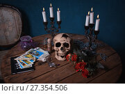 Купить «Mystic still life with skull, tarot cards, books and candles», фото № 27354506, снято 27 октября 2017 г. (c) Дмитрий Черевко / Фотобанк Лори