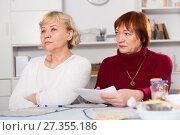 Купить «serious mature females with communal payments», фото № 27355186, снято 22 ноября 2017 г. (c) Яков Филимонов / Фотобанк Лори