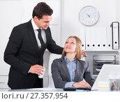 Купить «Sexual harassment between colleagues», фото № 27357954, снято 20 апреля 2017 г. (c) Яков Филимонов / Фотобанк Лори