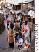 Купить «Two Maiko, Geisha apprentices, in colorful kimono on an old street in Higashiyama, Kyoto, Japan.», фото № 27368154, снято 19 ноября 2017 г. (c) age Fotostock / Фотобанк Лори