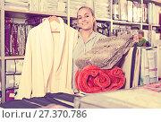Купить «Young happy woman customer buying multiple items», фото № 27370786, снято 24 сентября 2018 г. (c) Яков Филимонов / Фотобанк Лори